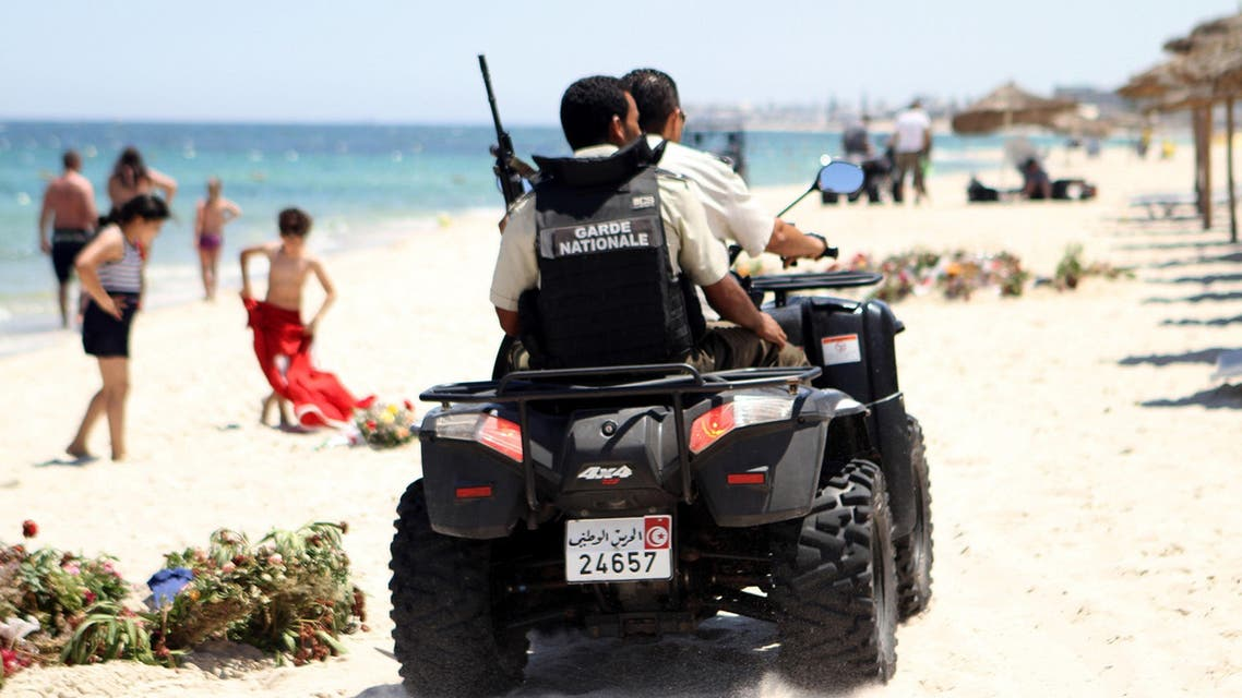 TUNISIA : Tunisian security forces patrol a beach in Sousse, south of the capital Tunis, on July 1, 2015 AFP