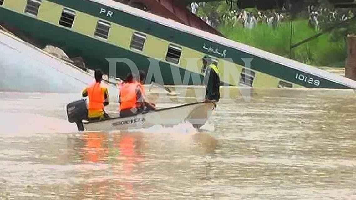 pakistan train falls into stream