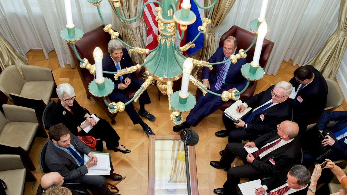 US Secretary of State John Kerry - seen through a chandelier - and his advisers sit with Russian Foreign Minister Sergey Lavrov and their counterparts on June 30, 2015, in Vienna, Austria. (File: AFP)
