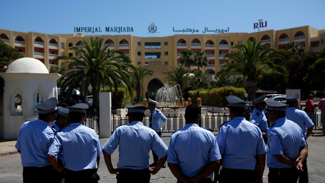 Tunisian police officers guard Imperial Marhaba hotel during visit of top security officials of Britain, France, Germany and Belgium in Sousse, Tunisia, Monday, June 29, 2015. AP