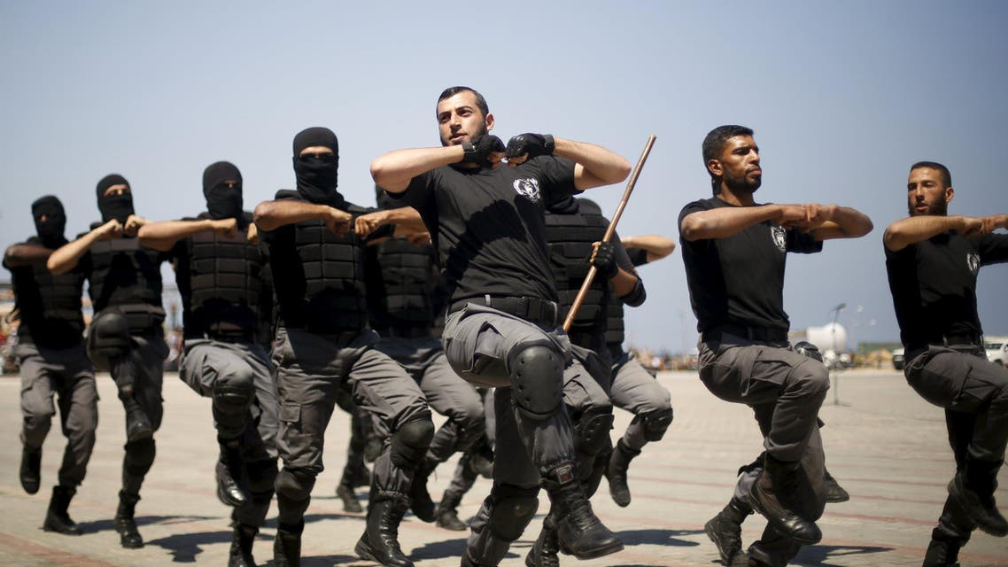 Palestinian policemen loyal to Hamas demonstrate their skills during a military graduation ceremony in Gaza City June 16, 2015.  (Reuters)