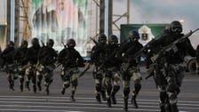 Saudi policeman killed in raid, ISIS flags found