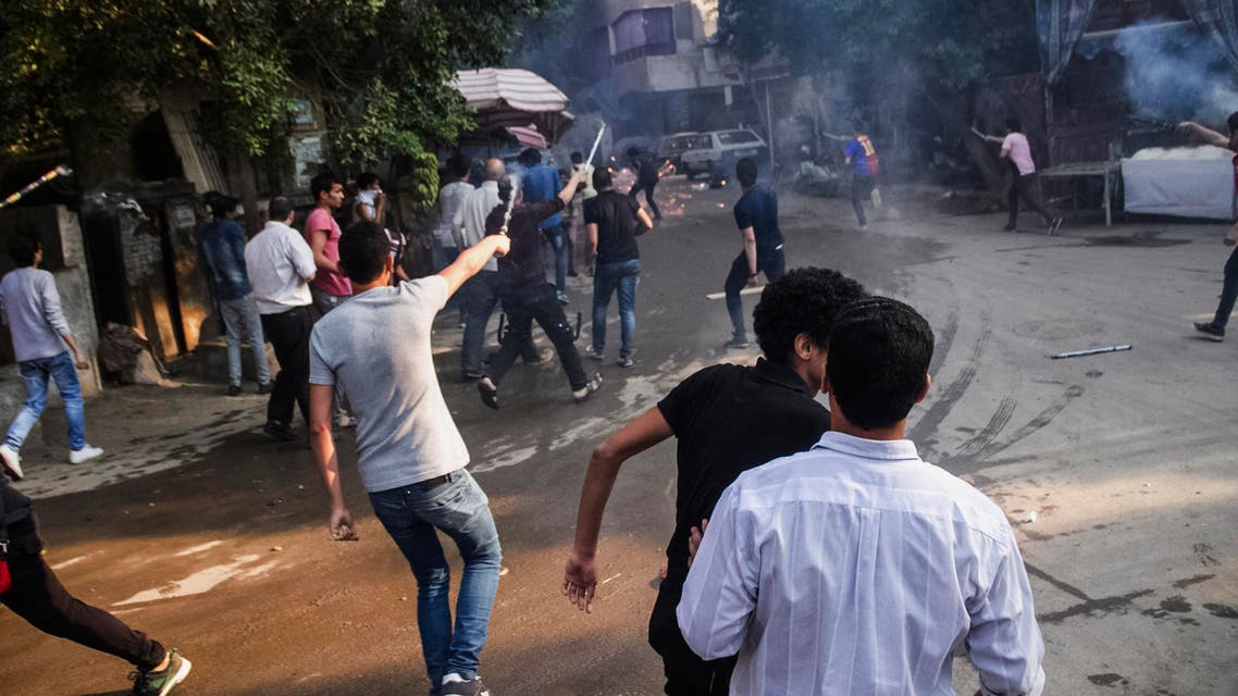 Supporters of the Muslim Brotherhood aim their fireworks toward Egyptian security forces following their protest against the government, while marching on a street in Cairo's Matariya district, Egypt, Tuesday, June 30, 2015. AP