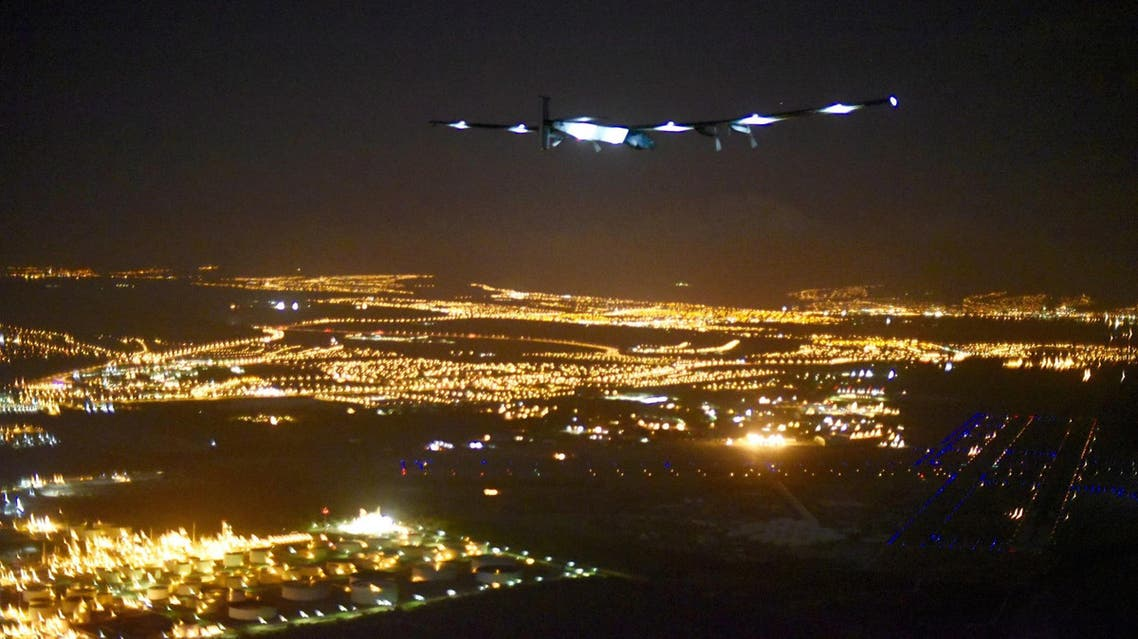 In this image released by Solar Impulse 2, the solar powered plane, piloted by Andre Borschberg approaches Honolulu Airport in Hawaii early Friday, July 3, 2015, after a record-breaking five-day journey across the Pacific Ocean from Japan. (Jean Revillard/Solar Impulse 2 via AP)