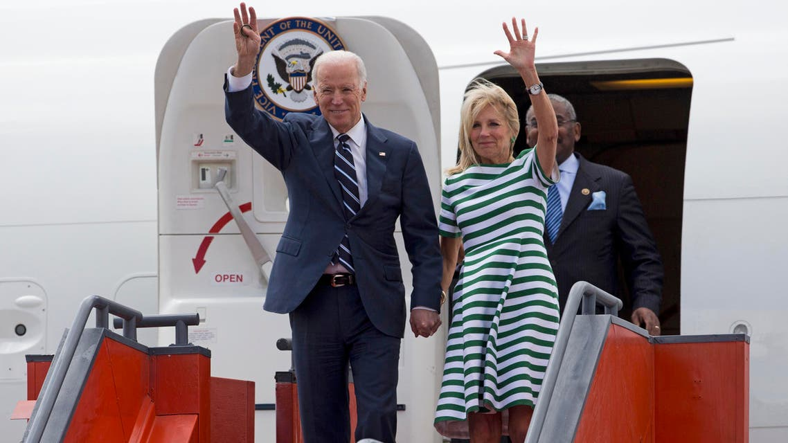 U.S. Vice President Joe Biden, left, and his wife Jill Biden wave as they arrive to an air force base in Guatemala City, Monday, March 2, 2015. (AP)