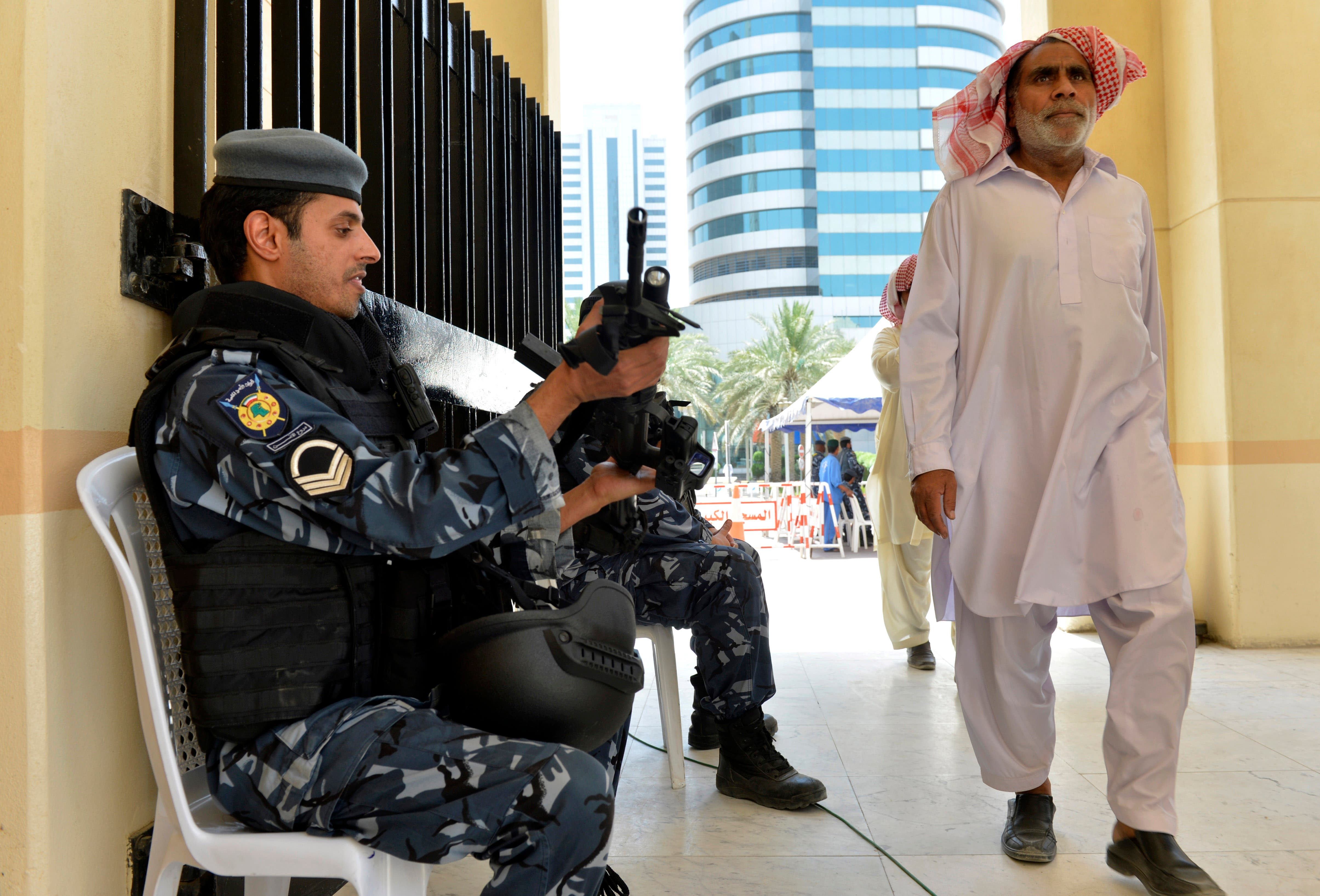 Kuwaiti police are on hand as worshippers arrive for joint Sunni-Shiite Friday prayers at the Grand Mosque in Kuwait City on Friday, July 3, 2015, one week after a suicide attack by an Islamic State sympathizer on Shiite worshippers. Instead of fueling the kind of sectarian animosity that has devastated Iraq and Syria, the Kuwait attack has reawakened a sense of national solidarity not seen since Saddam Hussein's 1990 invasion. (AP Photo)