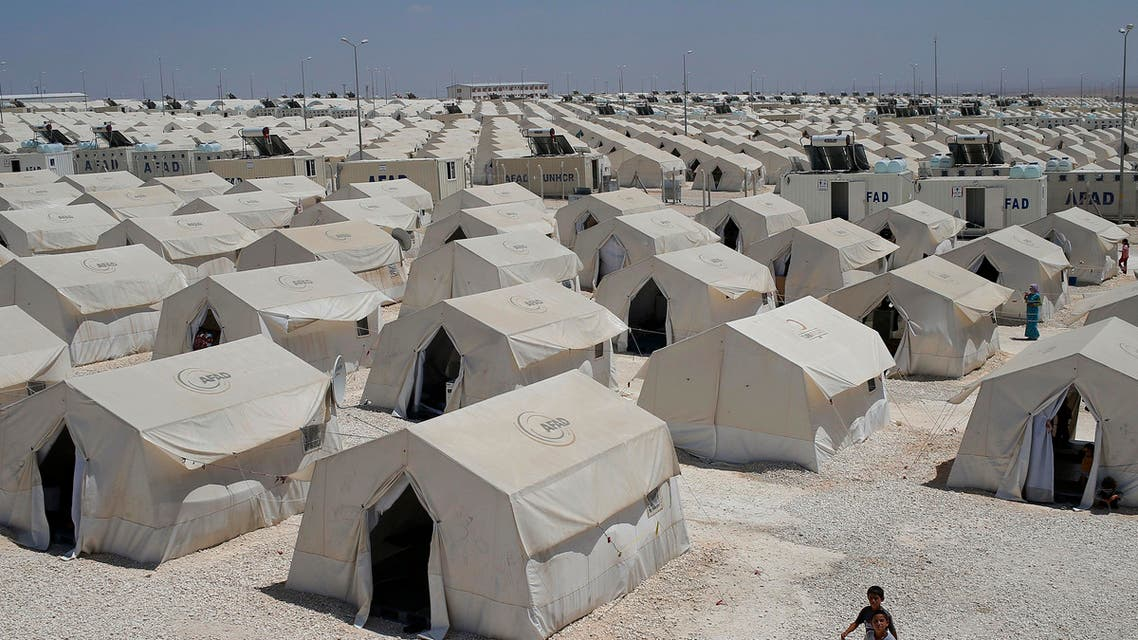 Syrian refugees wander around a refugee camp in Suruc, on the Turkey-Syria border, Friday, June 19, 2015.