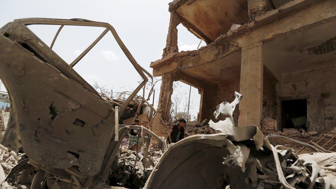 Boys walk at a site hit by a Saudi-led air strike in Yemen's capital Sanaa. reuters