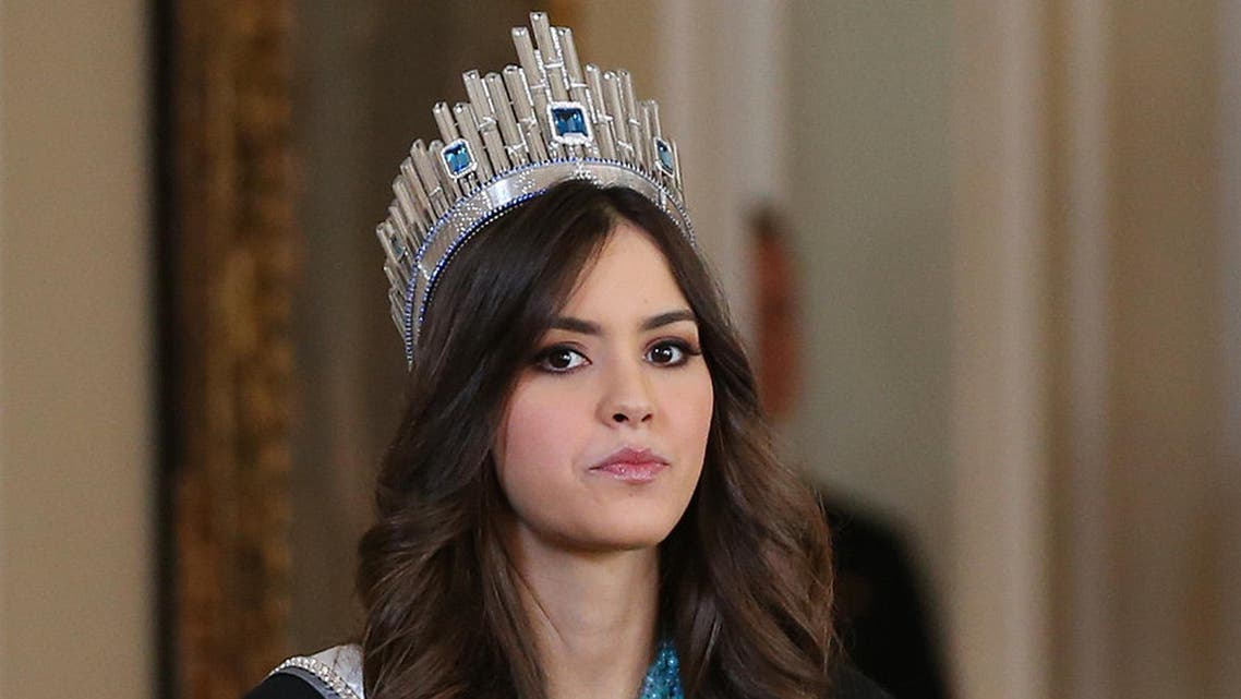 Miss Universe Paulina Vega, from Colombia, takes part in a welcoming ceremony at the Presidential Palace in Bogota, Colombia, Tuesday, April 28, 2015. Vega is in her native country for her first official visit since she was crowned Miss Universe in January. (AP Photo/Fernando Vergara)