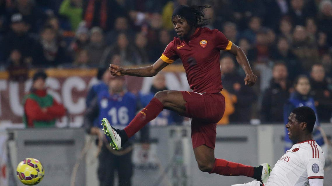 Roma's Gervinho, left, and AC Milan's Cristian Zapata fight for the ball during their Serie A soccer match between Roma and AC Milan at Rome's Olympic stadium, Saturday, Dec. 20, 2014. (AP)