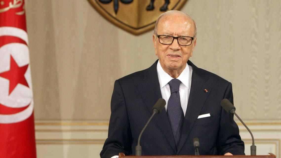 A handout picture released by the Tunisian Presidency Press Service shows Tunisian President Beji Caid Essebsi (R) speaking during a press conference in Tunis on July 4, 2015. (AFP)