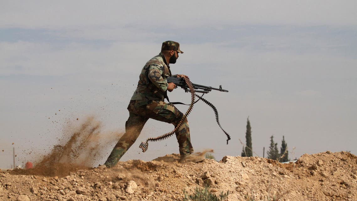 n this Friday, Nov. 22, 2013 file photo, a Shiite fighter clashes with members of the Sunni-dominated Free Syrian Army rebel in the town of Hatita, in the countryside of Damascus, Syria.AP