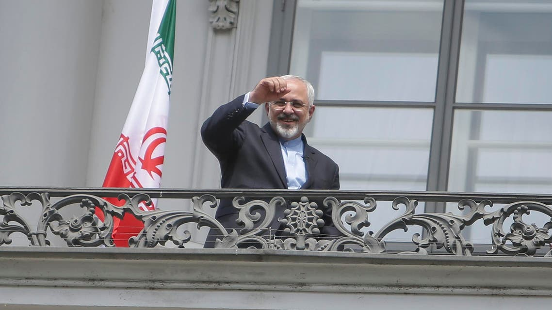 Iranian Foreign Minister Zarif stands on the balcony of Palais Coburg, the venue for nuclear talks in Vienna. (Reuters)