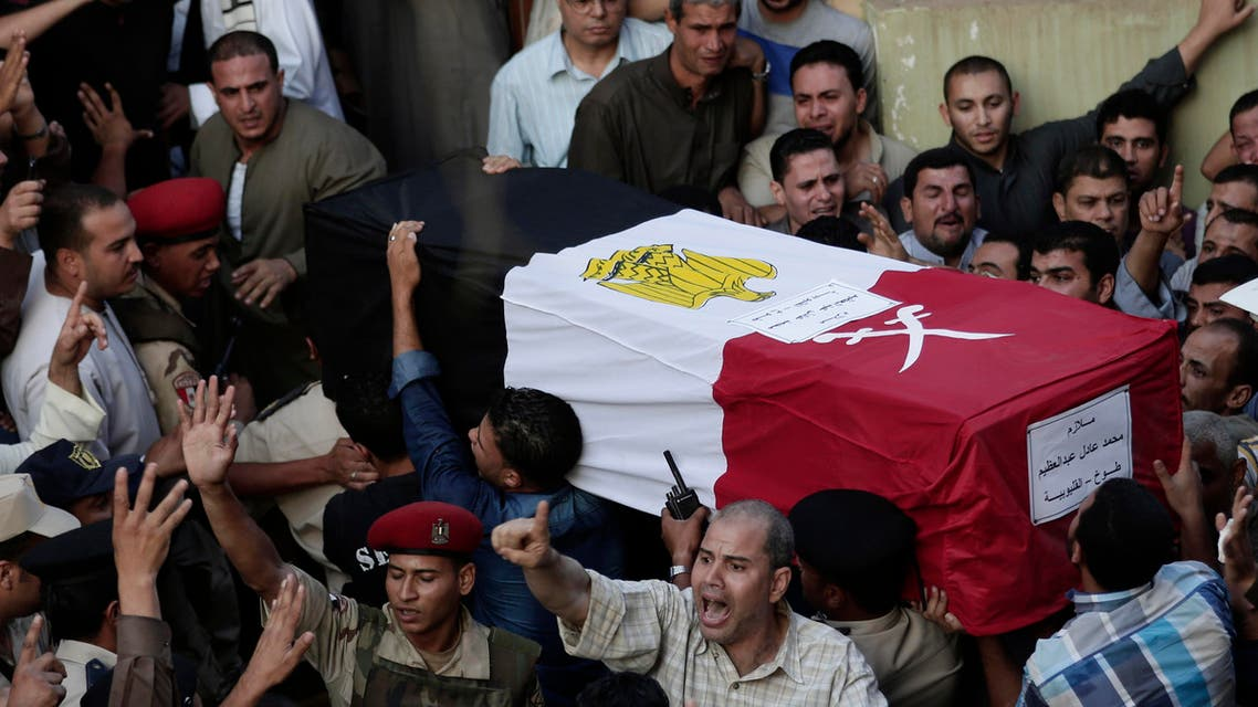 Egyptians carry the coffin of 1st Lt. Mohammed Adel Abdel Azeem, killed in Wednesday's attack by Islamic militants in the Sinai, during the funeral procession at his home village Tant Al Jazeera in Qalubiyah, north of Cairo, Egypt, Thursday, July 2, 2015. AP