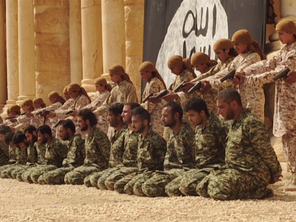 The ISIS fighters - who appear to be teenagers - line up their pistols to kill the soliders (Video grab)
