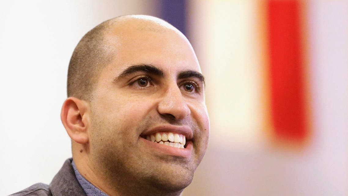 Steve Salaita, a professor who lost a job offer from the University of Illinois over dozens of profane, anti-Israel Twitter messages, speaks during a news conference in Champaign Ill. AP