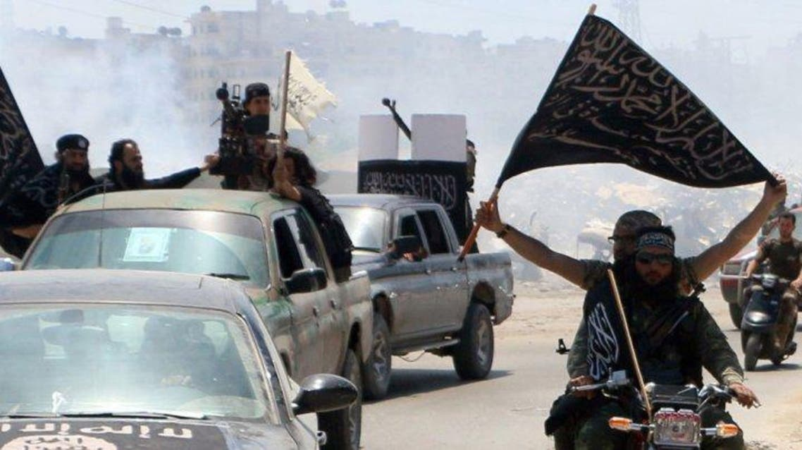 Fighters from al Qaeda's Syrian affiliate Al-Nusra Front drive in the northern Syrian city of Aleppo flying Islamist flags as they head to a frontline, on May 26, 2015  (AFP)