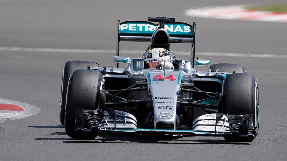 British Mercedes driver Lewis Hamilton steers his car during the qualyfying for the British Formula One Grand Prix at Silverstone circuit, Silverstone, England, Saturday, July 4, 2015. AP