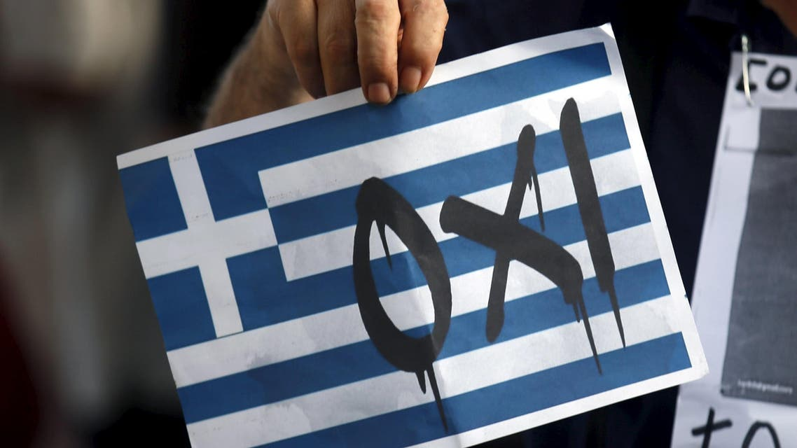"A man holds a sign that reads, ""No"", supporting Greece during a pro-Greece protest in front of European Union office in Barcelona, Spain. (Reuters)"