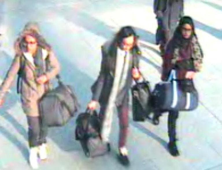 A CCTV image received by London's Metropolitan Police (MPS) on February 23, 2015 shows (L-R) British teenagers Amira Abase, Kadiza Sultana and Shamima Begum (Still courtesy of Metropolitan Police)