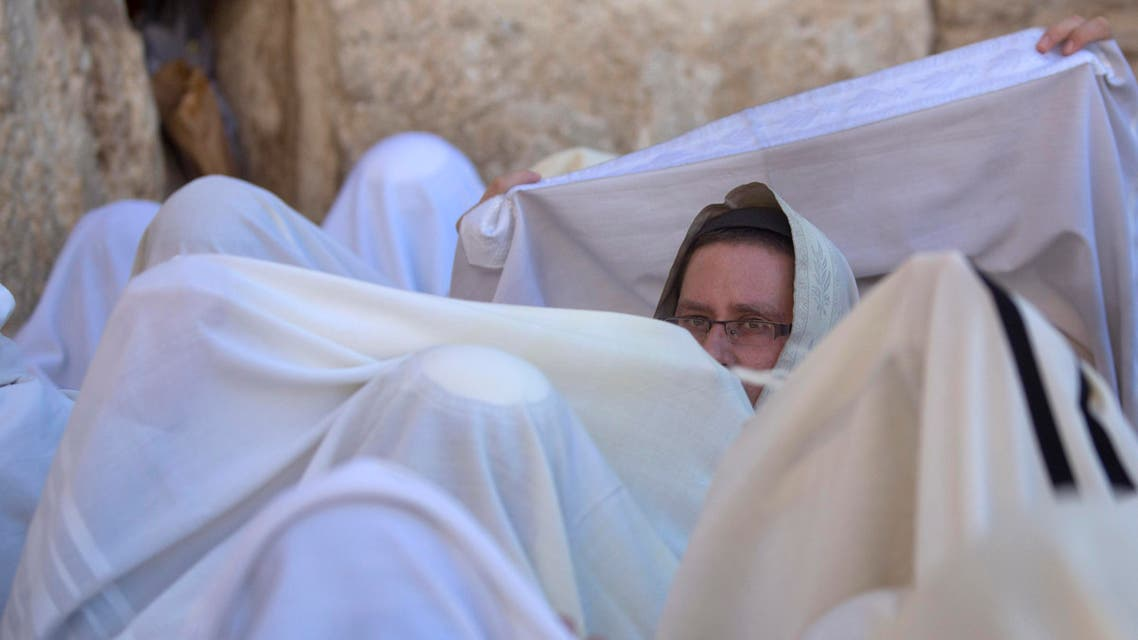 Covered in prayer shawls, Israeli ultra-orthodox Jewish men of the Cohanim Priestly caste participate in a blessing during the Jewish holiday of Passover. (File: AP)