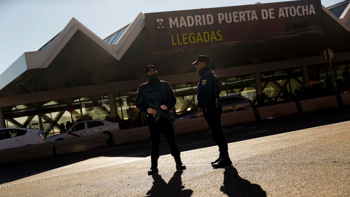 Armed police officers stand guard outside Atocha train station in Madrid, Spain. (File: AP)