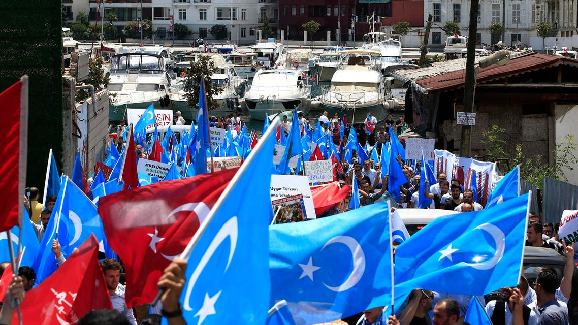 Uighurs living in Turkey and Turkish supporters carrying Turkish and flags of what ethnic Uighurs call 'East Turkestan', during a protest near China's consulate in Istanbul, Sunday, July 5, 2015 (AP)