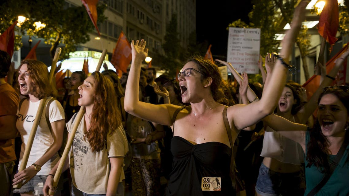 """No"" supporters celebrate referendum results on a street in central in Athens, Greece July 5, 2015. (Reuters)"