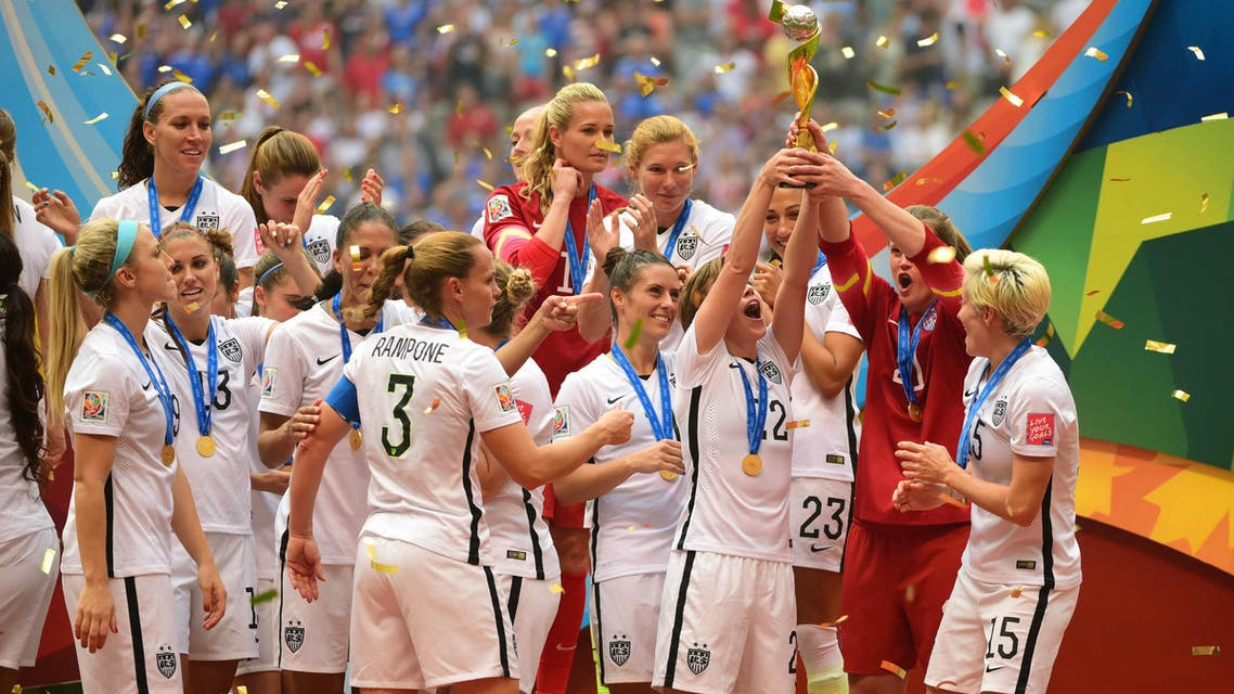 United States players react as they receive the FIFA Women's World Cup trophy after defeating Japan. (Reuters)