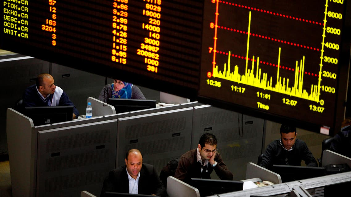 In this Jan. 21, 2013 file photo, Egyptian traders work at the stock market in Cairo, Egypt. Egypt's government on Monday, May 18, 2015, suspended a tax imposed on the market's capital gains, for two years causing shares to rise in early trading. The suspension comes nearly a year after President Abdel-Fattah el-Sissi approved the law, which put 10 percent tax on capital gains that fueled a sell-off by investors. Some investors went to courts to abolish government's law. (AP Photo/Amr Nabil, File)