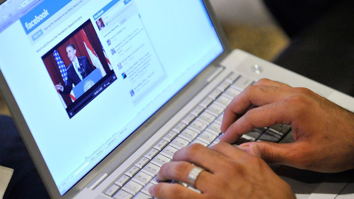 Muslim American Zabie Mansoory, 23, monitors a Facebook discussion board while watching President Barack Obama's televised coverage of President Barack Obama's speech from Cairo University, in the Sylmar area of Los Angeles, early Thursday June 4, 2009. (AP Photo/Gus Ruelas)