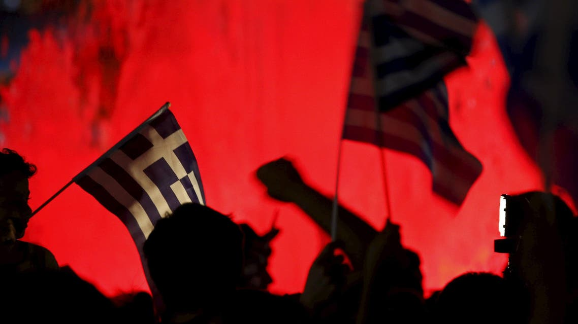 """""""No"""" supporters wave Greek national flags on the main Constitution (Syntagma) square in Athens, Greece. (Reuters)"""