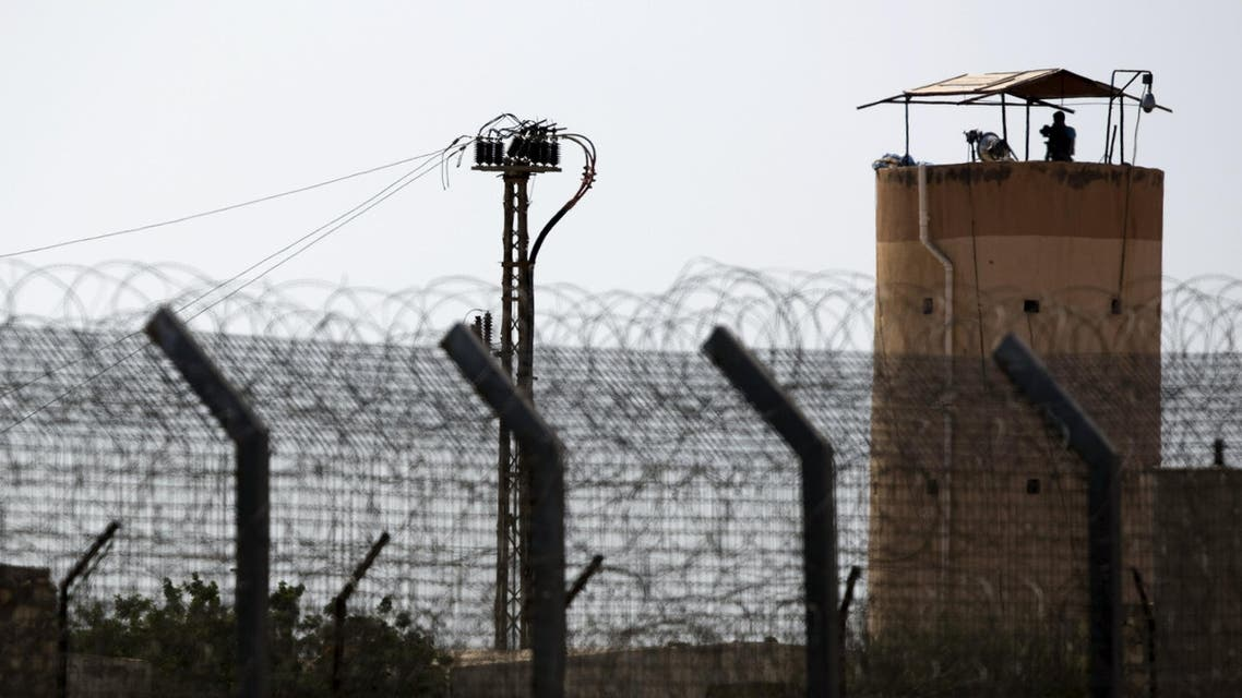 A member of Egypt's security forces stands on a watchtower in North Sinai as seen from across the border in southern Israel July 1, 2015. Islamic State militants launched a wide-scale coordinated assault on several military checkpoints in North Sinai on Wednesday in which 50 people were killed, security sources said, the largest attack yet in the insurgency-hit province. Egyptian army F-16 jets and Apache helicopters strafed the region that lies within the Sinai Peninsula, a strategic area located between Israel, the Gaza Strip and the Suez Canal. REUTERS/Amir Cohen