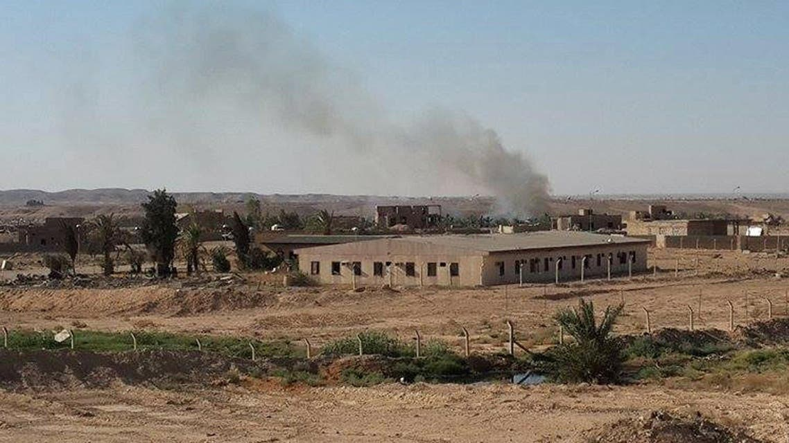 Smoke rises after an airstrike by the U.S.- led coalition against Islamic State group near the city of Haditha, 240 kilometers (150 miles) northwest of Baghdad, Iraq, Monday, July 6, 2015. (AP Photo)