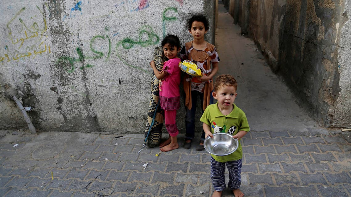 Palestinian children pose for a photo in Jebaliya refugee camp in the northern Gaza Strip, Thursday, May 14, 2015. AP