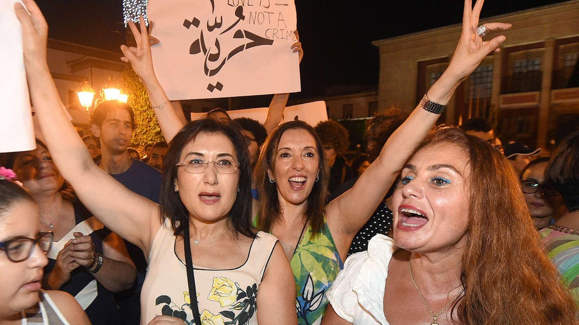 Moroccans shout slogans and hold placards during a demonstration in Rabat on July 6, 2015. The protesters demonstrated for freedom and against the arrest of two Moroccan women after their outfits were deemed inappropriate. (AFP)