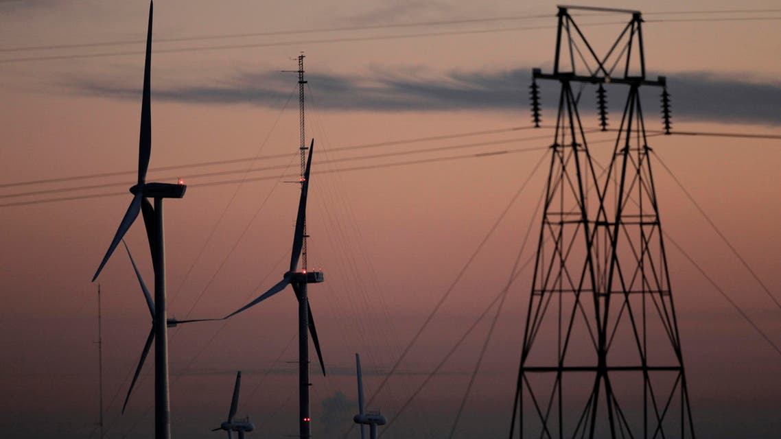 This Nov. 3, 2012 file photo shows wind turbines, alongside an electrical tower, at the National Wind Technology Center, run by the U.S. Department of Energy, outside Boulder, Colo. Reuters
