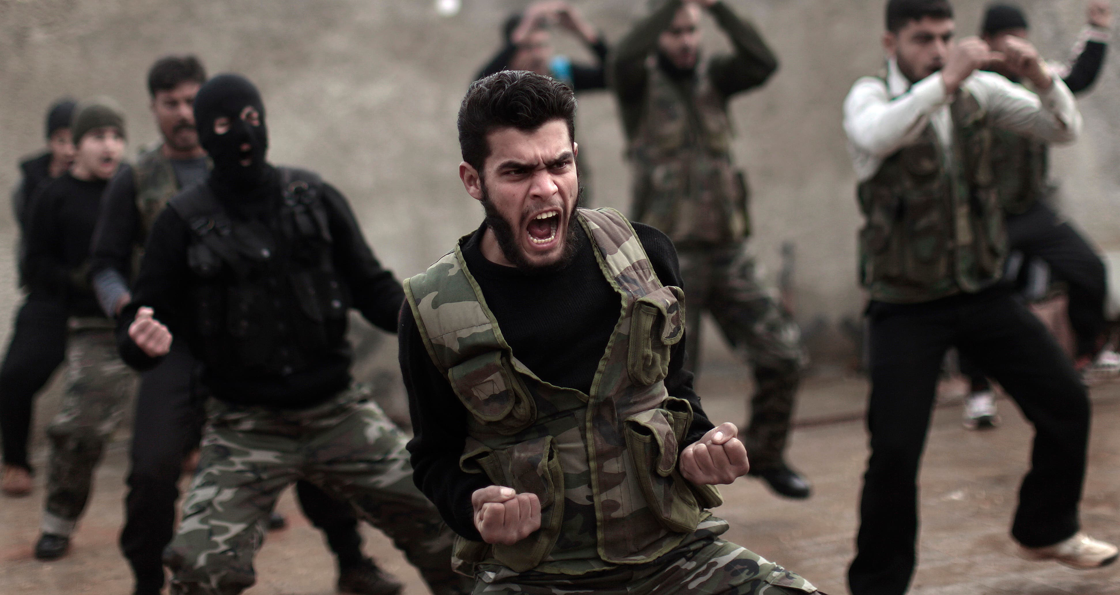 Syrian rebels attend a training session in Maaret Ikhwan near Idlib, Syria. Fewer than 100 Syrian rebels are currently being trained by the U.S. military. AP