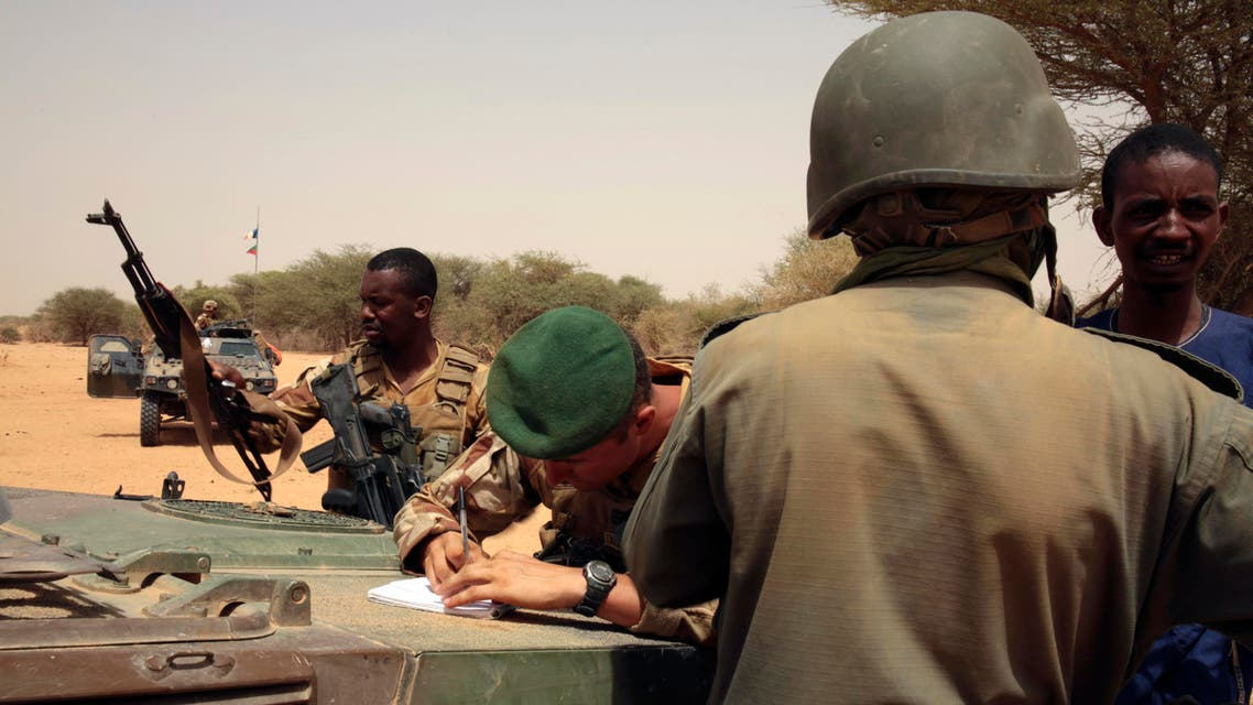 In this photo taken June 23, 2015, French forces disarm a man during a patrol in the desert of Northern Mali along the border with Niger on the outskirts of Asongo, Northern Mali. French forces help to disarm groups in northern Mali after a peace deal reached. (AP Photo/Maeva Bambuck)