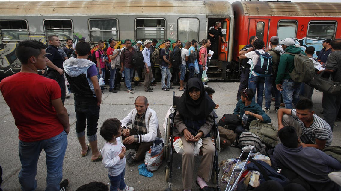 Migrants from Syria and Afghanistan wait to board a train to Serbia at the railway station in the southern Macedonian town of Gevgelija, on Monday, June 22, 2015. (File Photo:AP)