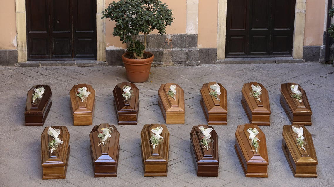 Coffins of 13 unidentified migrants who died in the April 19, 2015 shipwreck, are seen during an inter-faith funeral service in Catania, Italy July 7, 2015. Italy held a funeral service on Tuesday for 13 migrants who died in the worst shipwreck in the Mediterranean in recent history, while the navy continued its search for other victims of the disaster. More than 700 people, most of them locked below deck, were believed to have drowned in April. Their overloaded fishing boat capsized after colliding with a ship that had come to their aid some 70 nautical miles off the coast of Libya. REUTERS/Antonio Parrinello
