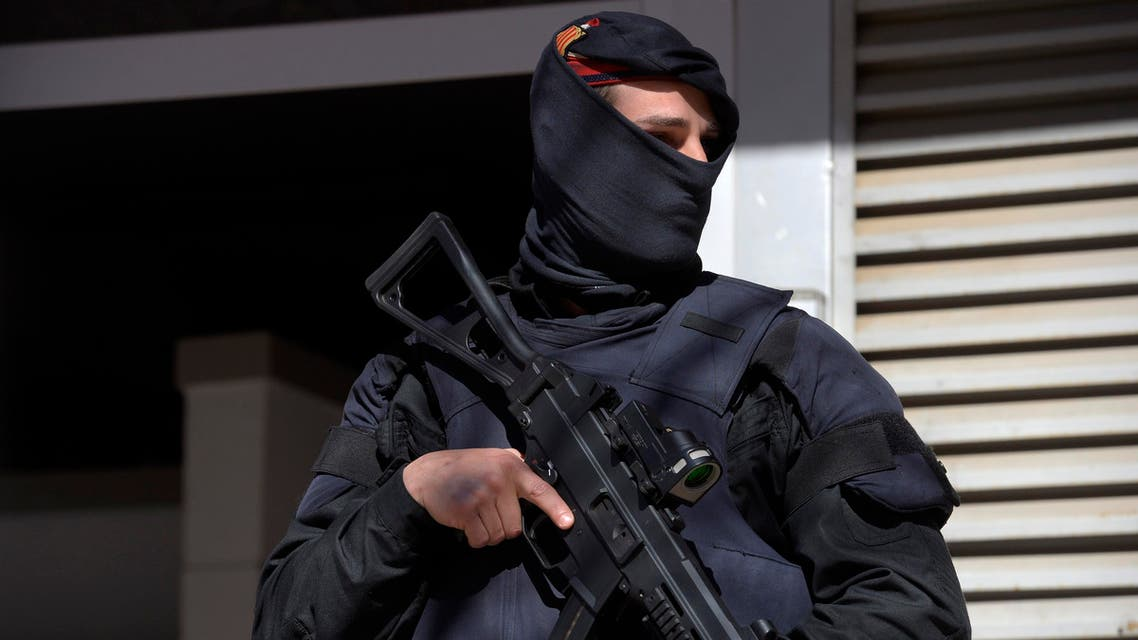 A Mossos d'Esquadra regional police officer stands guard during a raid in one of the region's biggest operations against jihadi activity in Sabadell, near Barcelona, Spain, Wednesday, April 8, 2015. AP