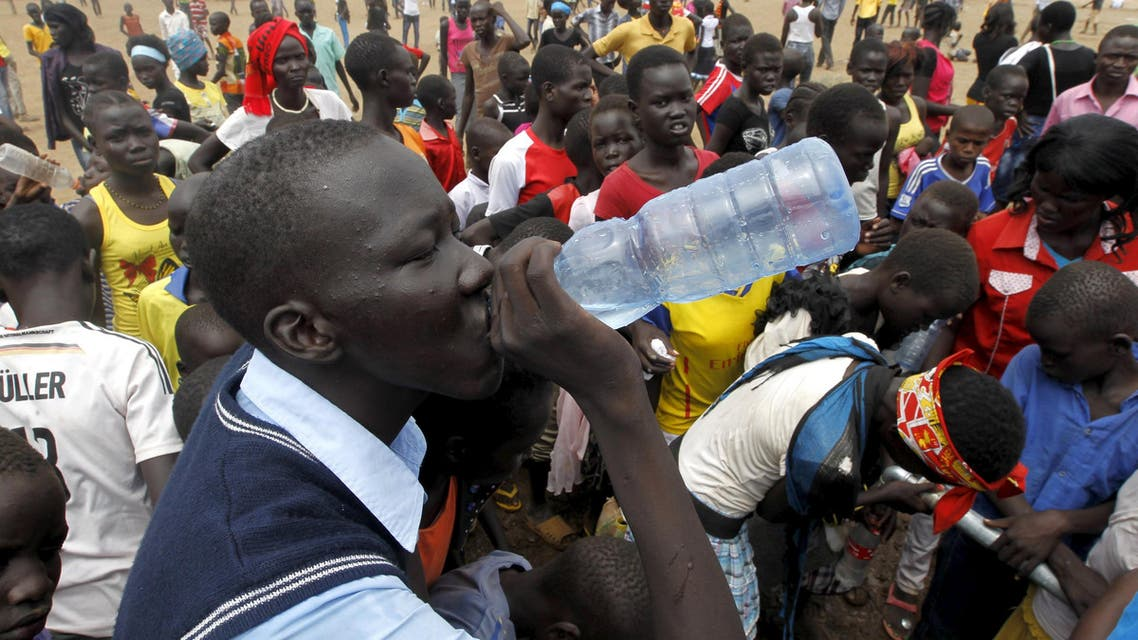 A refugee from South Sudan drinks water at a well during celebrations to mark World Refugee Day at the Kakuma refugee camp in Turkana District, northwest of Kenya's capital Nairobi, June 20, 2015. June 20 is World Refugee Day, an occasion that draws attention to those who have been displaced around the globe. REUTERS/Thomas Mukoya