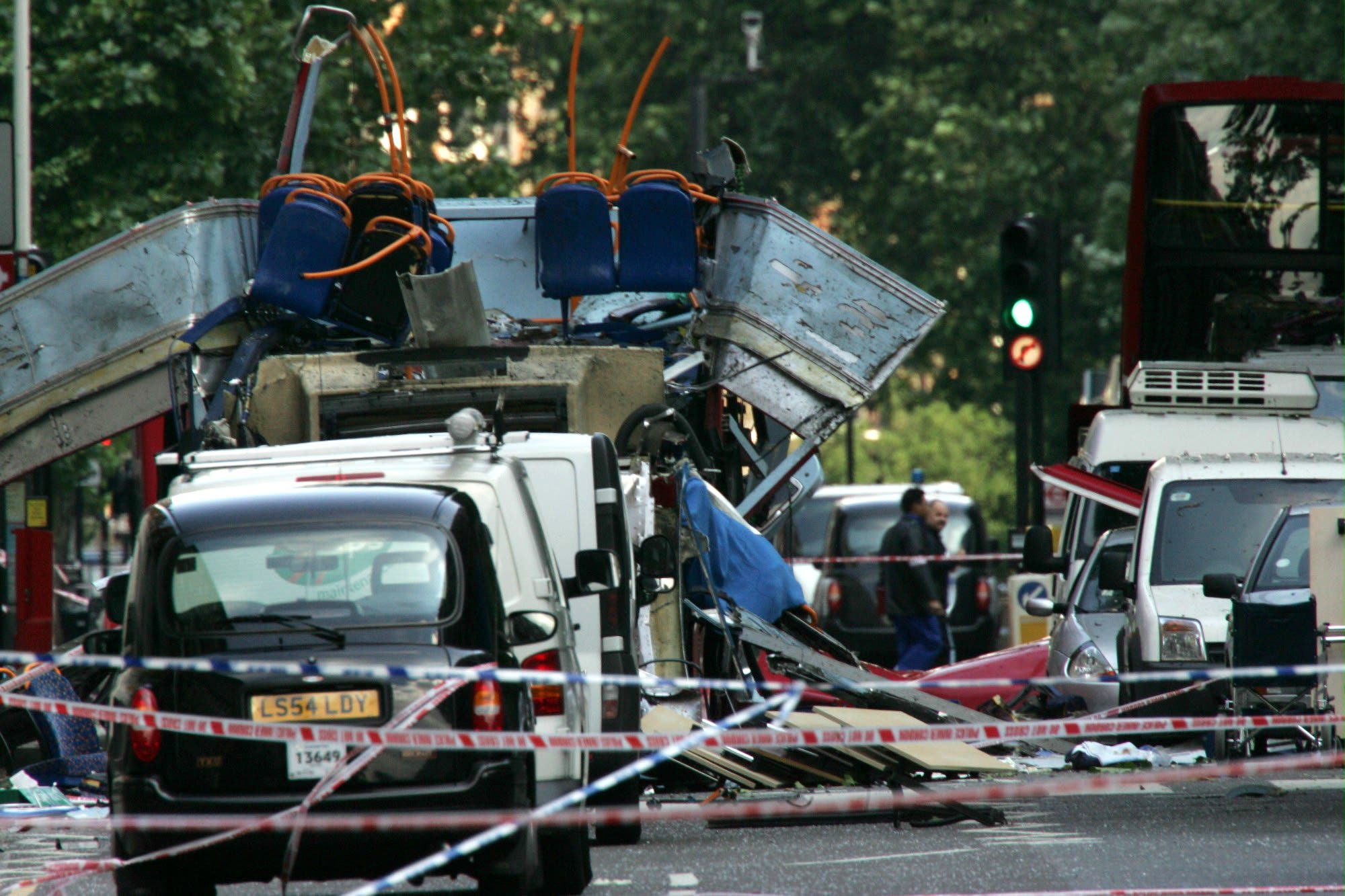 The wreckage of a double-decker bus with its top blown off and damaged cars scattered on the road at Tavistock Square in central London in this July 7, 2005. (File Photo:AP)