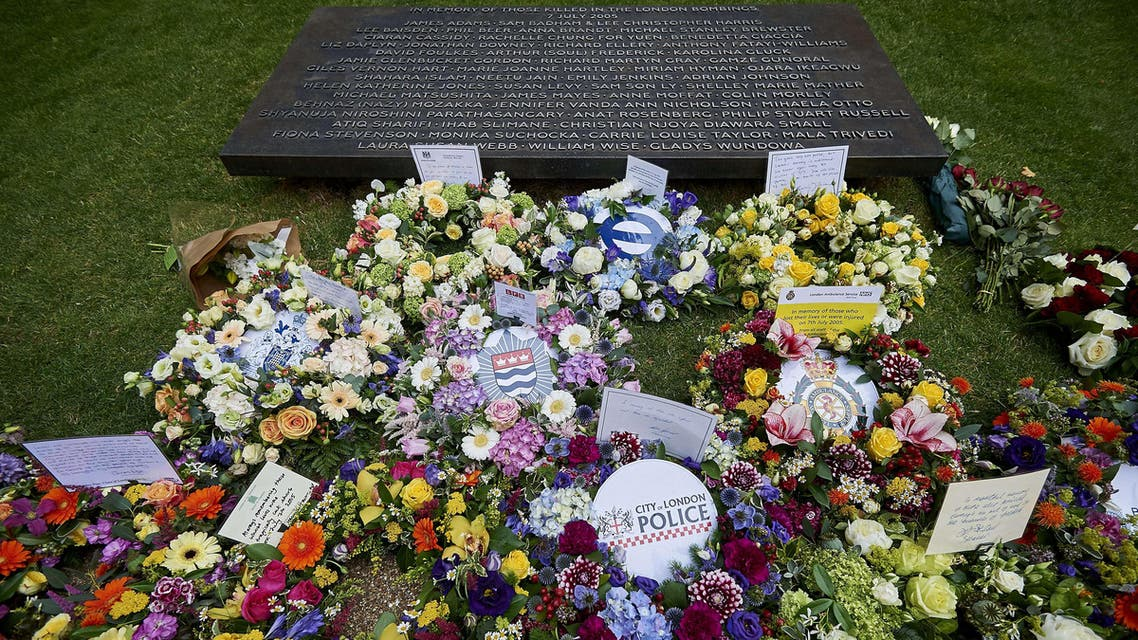 Floral tributes and messages are pictured following a wreath laying ceremony in London's Hyde Park on July 7, 2015, in memory of the 52 victims of the 7/7 London attacks. (AFP)