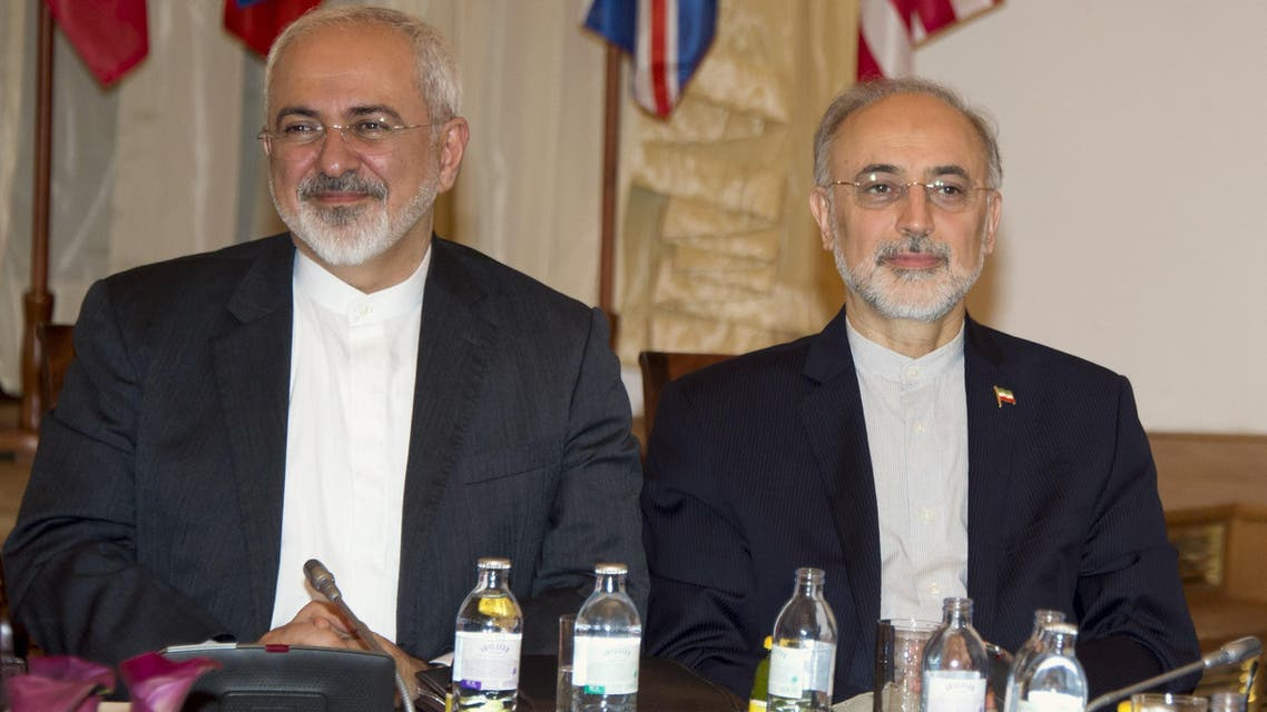 Iranian Foreign Minister Mohammad Javad Zarif (L) and the Head of the Iranian Atomic Energy Organization Ali Akbar Salehi attend Iran nuclear talks meetings in Vienna, Austria on July 6, 2015. (AFP)