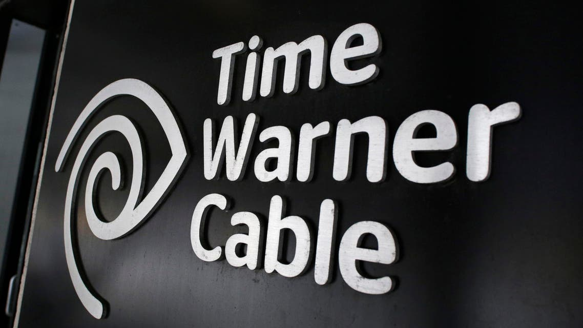 The Time Warner Cable corporate logo is displayed at a company store, Tuesday, May 26, 2015 in New York. Charter Communications is buying Time Warner Cable for $55.33 billion. AP