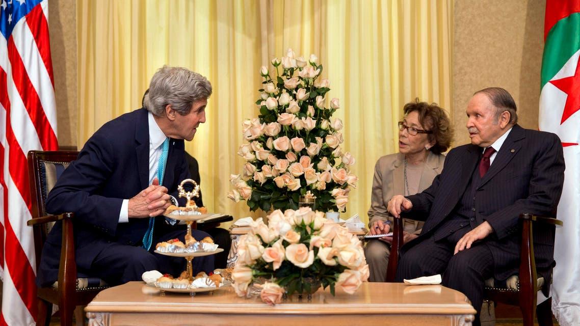 U.S. Secretary of State John Kerry leans in to hear what Algerian President Abdelaziz Bouteflika, right, is saying during their meeting in Zeralda outside of Algiers, Algeria, Thursday, April 3, 2014. (AP)