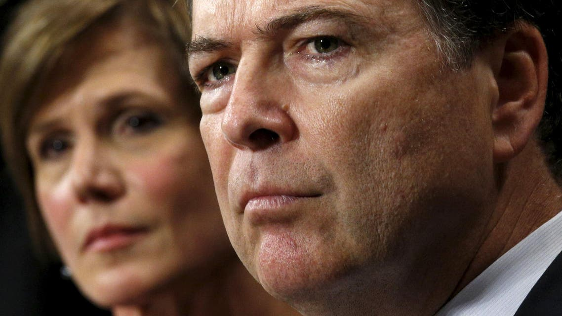 """U.S. Deputy Attorney General Sally Quillian Yates (L) and FBI Director James Comey testify during a Senate Judiciary Committee hearing on """"Going Dark: Encryption, Technology, and the Balance Between Public Safety and Privacy"""" in Washington July 8, 2015. REUTERS/Kevin Lamarque"""