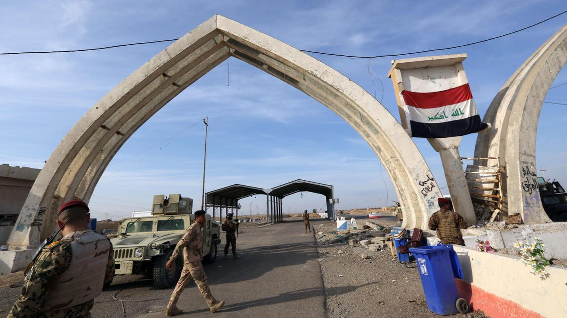 In this file photo taken Monday, Dec. 8, 2014, Iraqi security forces and Shiite fighters are deployed during a military operation to regain control of the university of Tikrit, 80 miles (130 kilometers) north of Baghdad, Iraq. AP